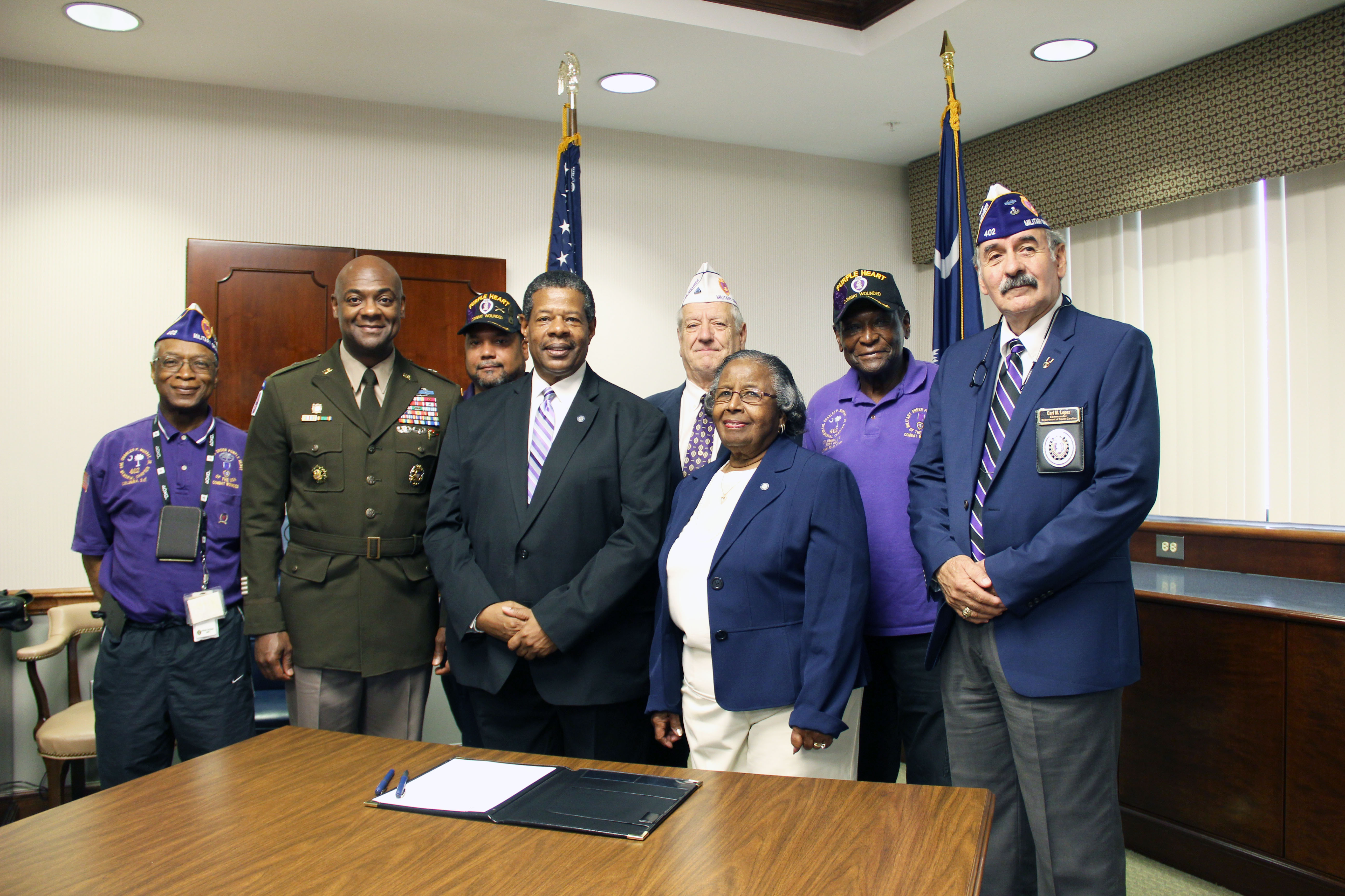 MTC Leadership accepting designation as a purple heart college.